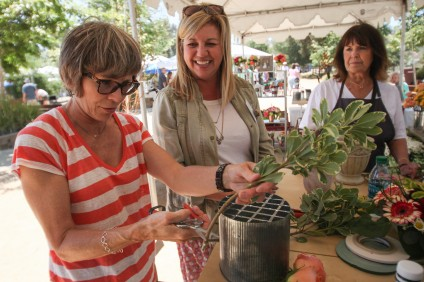 Visitors participate in a workshop at the 2015 Eco Garden Expo in Los Rios Park. Photo: Allison Jarrell