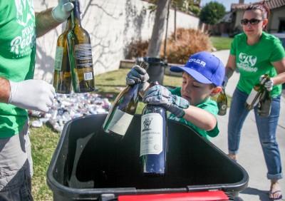 Six-year-old Ryan Hickman recycling at his San Juan Capistrano home. Photo: Allison Jarrell