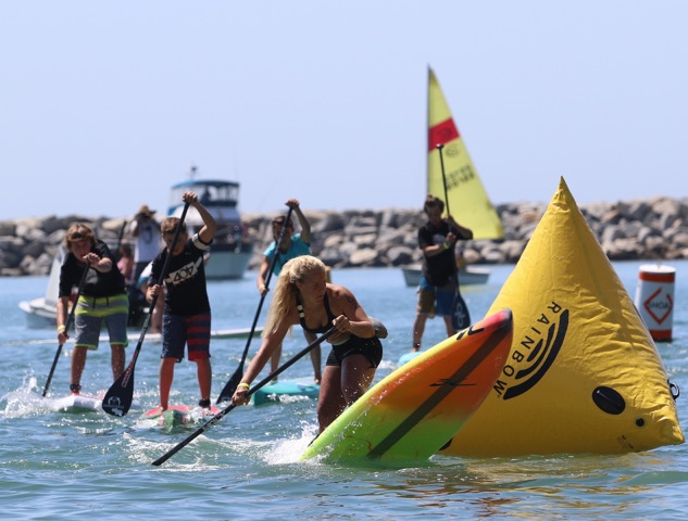 Competitors make a turn around a buoy during the 2015 Mongoose Cup. Photo: Mike Muir