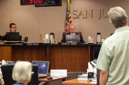 "Councilman Derek Reeve, left, and Councilman John Perry listen to Rob Williams defend his position on the Planning Commission on May 3. Reeve requested the Council remove Williams from the commission, saying his continued review of the Historic Town Center Master Plan and the Hotel Capistrano project ""continue to create the appearance of conflict."" Photo: Allison Jarrell"