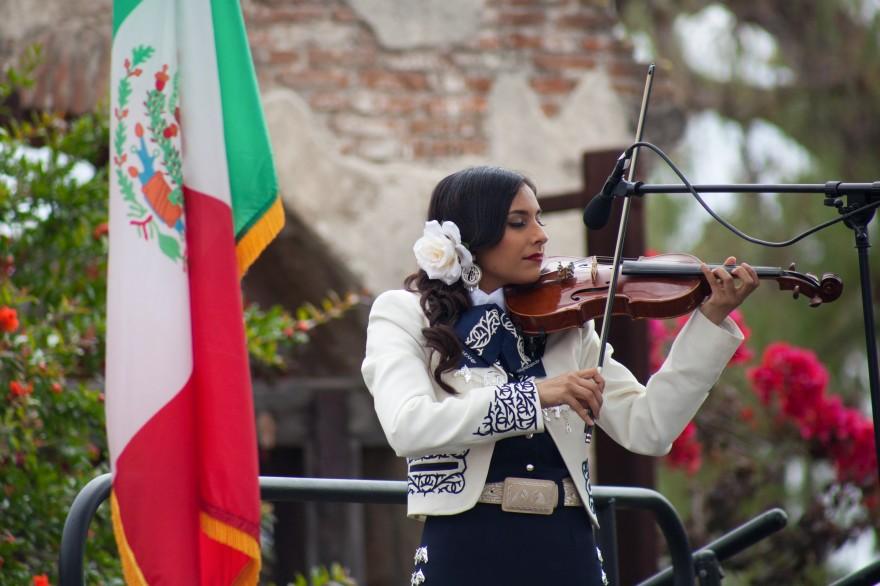 Angelica Martinez, 21, of San Clemente, plays the violin in Mariachi Nuevo Capistrano. Photo: Allison Jarrell