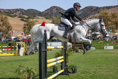 Following the ceremony, show jumpers competed in the $30,000 Markel Insurance Grand Prix at the Oaks International Grand Prix Field at the Rancho Mission Viejo Riding Park at San Juan Capistrano. Photo: Allison Jarrell