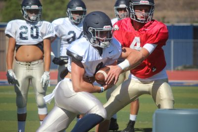 Brock Cazel runs the ball during a San Juan Hills football practice. Photo: Steve Breazeale