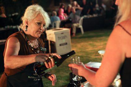 Hamilton Oaks event planner Cheryl Valenzano pours a glass of wine from Hamilton Oaks Winery at last year's Vintage Festival. Photo: Allison Jarrell