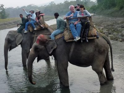 Tourists enjoy a ride atop elephants. Photo: Courtesy of Tom Blake