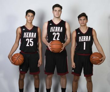 L to R: CJ Ursetta, Sebastian Much, Jordan Alvarado and the JSerra boys basketball team will have a new coach and a new style this season. Photo: Courtesy