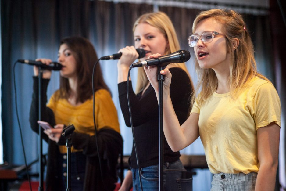 (From right) Jordan McFadden, of Dana Point, Alex Oliver, of Aliso Viejo, and Taylor Hopper, of San Clemente, perform a song off of Fleetwood Mac's Rumours. Photo: Allison Jarrell