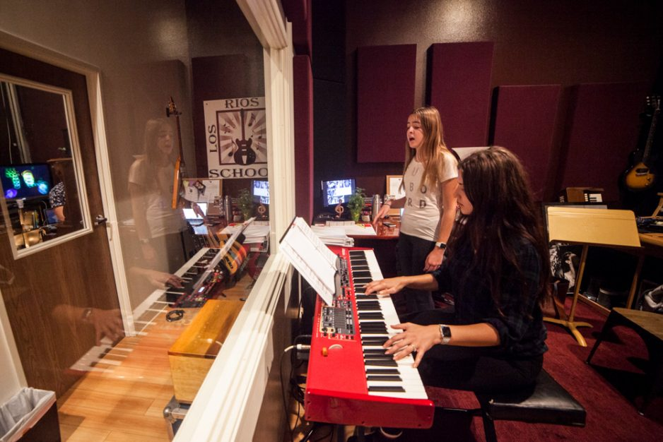 Olivia McHenry, 13, of Laguna Niguel, practices her vocals for an upcoming show with instructor Erin Blagdon on piano. Photo: Allison Jarrell