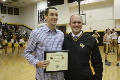 Capo Valley principal Josh Hill, right, presents the Spirit of the Cougar award to Kyle Hendricks before a basketball game on Feb. 3. Photo: Steve Breazeale