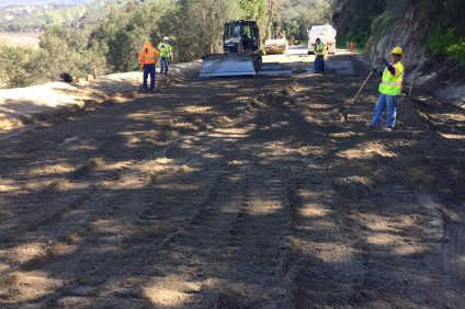 Workers are seen repairing the eastbound roadside, grading the pipe inlet by the headwall and finishing up the slope repair along Ortega Highway. Photo: Courtesy of Caltrans