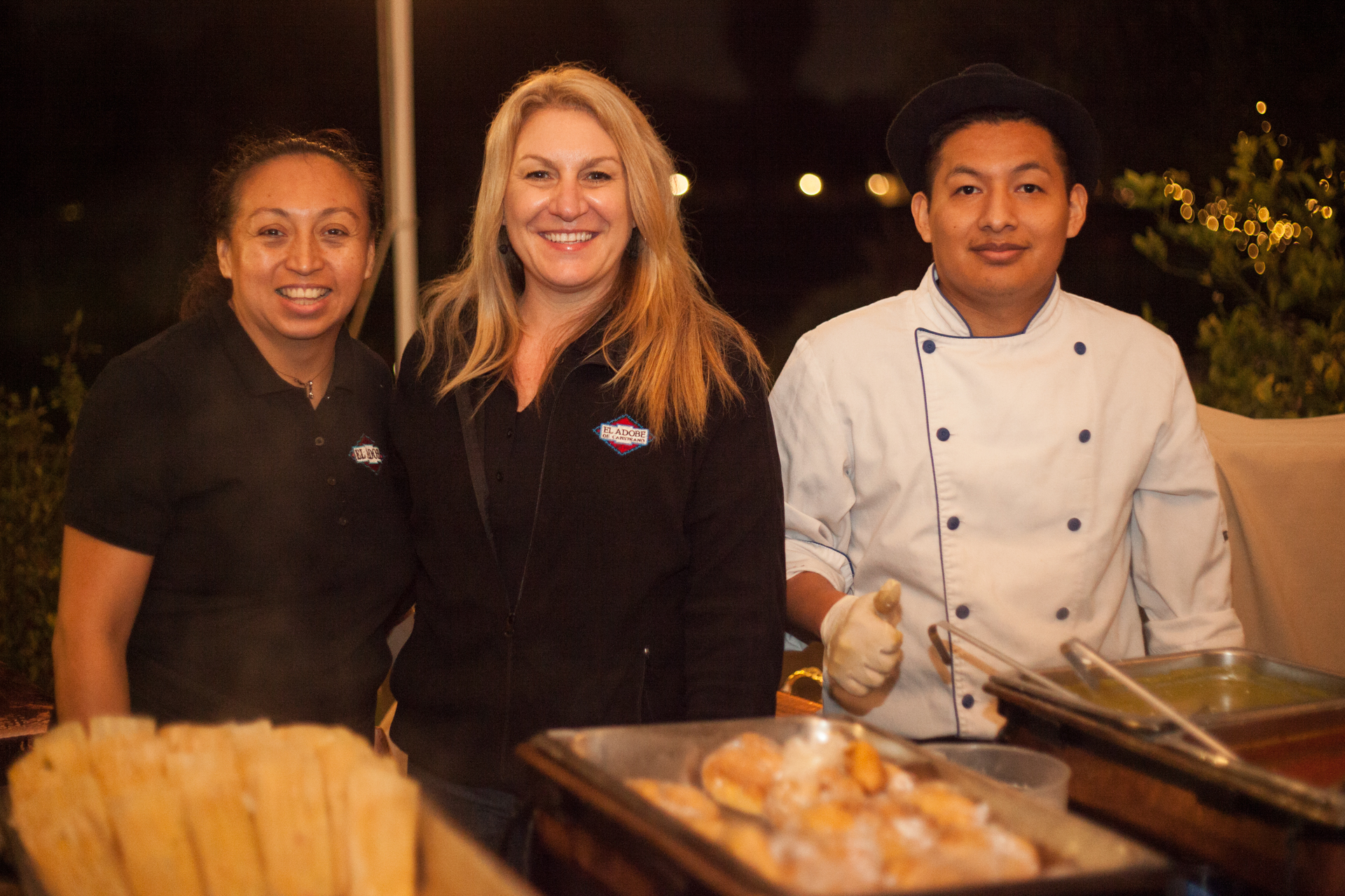 (Left to Right) From El Adobe de Capistrano, Gilda Sanchez, banquet captain; Herlinda Gregory, special events manager; and cook Benjamin Garcia served vegetable tamales with concaste sauce alongside chile relleno. Photo: Alex Paris