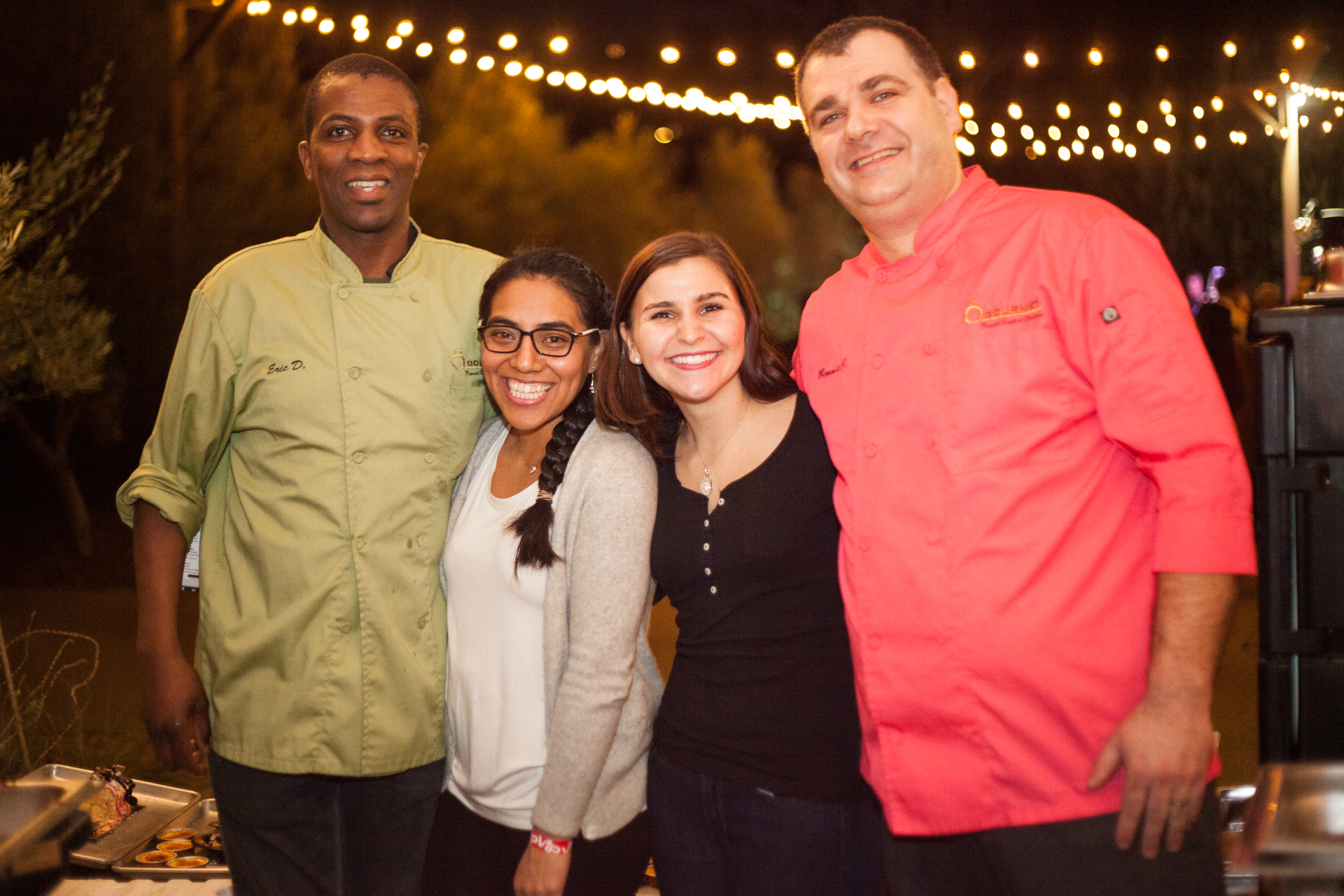 (Left to Right) From Ô Gourmet French Café & Bakery, chef/owner Eric Djomby, Alejandra Lopez, Laura Borrusa, and chef/owner Benoit Jussaume served Boeuf Bourguignon, creme brule and tarte tatin. Photo: Alex Paris