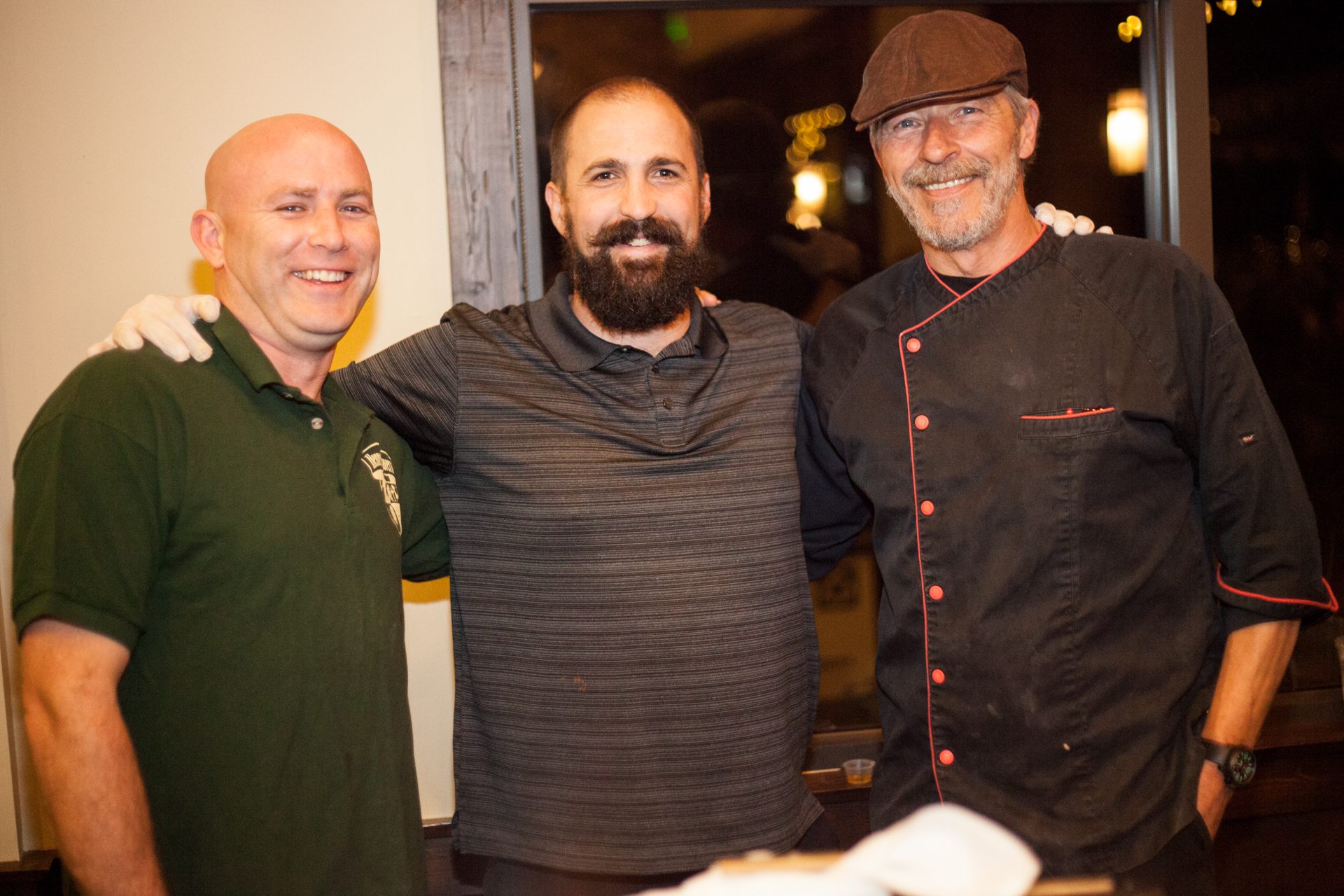 (From left) General manager Mike Soleri, cook Tommy O'Rafferty, and chef John Byrne, of Hennessey's Tavern, served chili to guests. Photo: Alex Paris