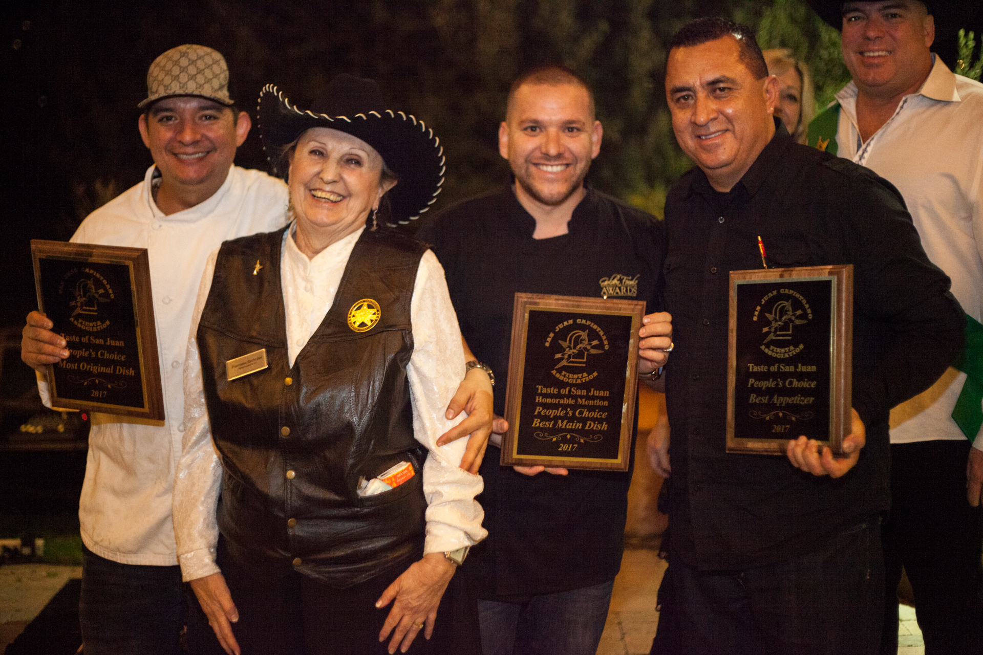 (From left) Chef Manny Velasco, Fiesta board member Pamela Schuler, owner Jesus Galvez, and team member Alfonso Montoya pose with their awards. Photo: Alex Paris