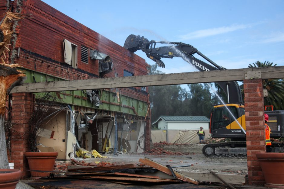 Part of the Birtcher-Pacific Building—which sat vacant at the Hotel Capistrano site—is seen being demolished on Feb. 14. The approved hotel project is currently mired in litigation. Photo: Allison Jarrell