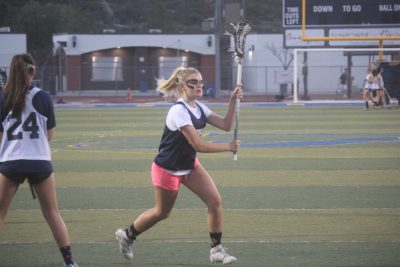 Taylor Austin looks for an opening during a San Juan Hills girls lacrosse practice. Photo: Steve Breazeale