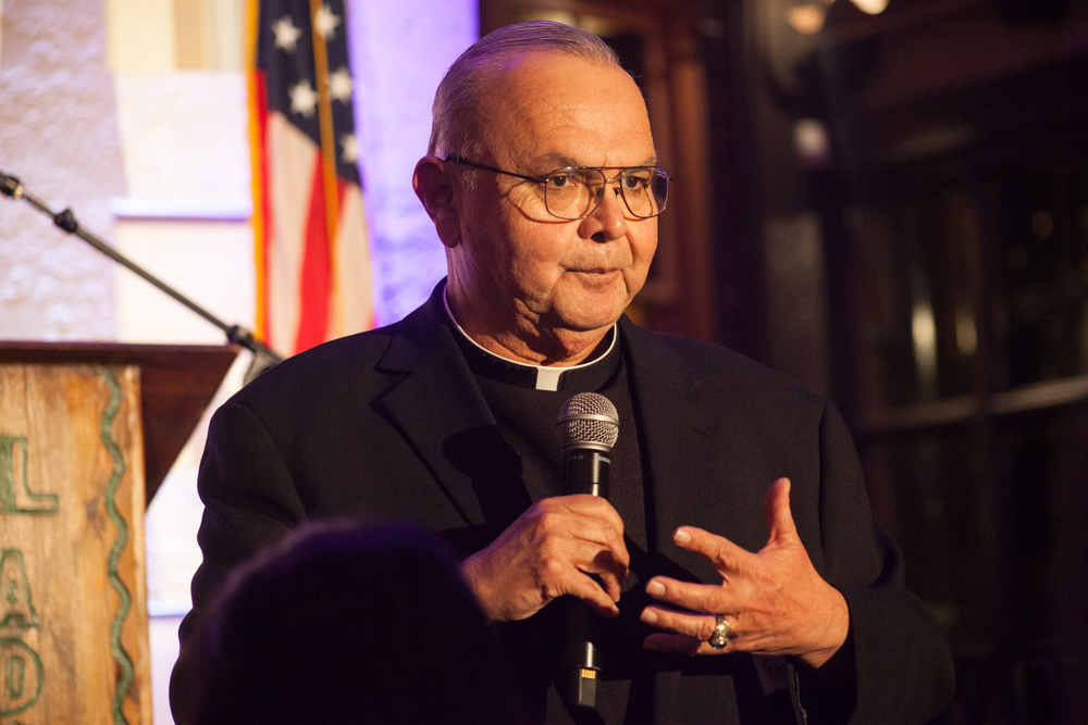 Father James Nieblas begins the 2017 State of the City address with a blessing. Photo: Allison Jarrell