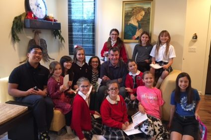 Members of the Precious Flowers—a group of second- to sixth-grade Mission Basilica School students—pose with Wells of Life founder Nick Jordan. Photo: Courtesy of Precious Flowers