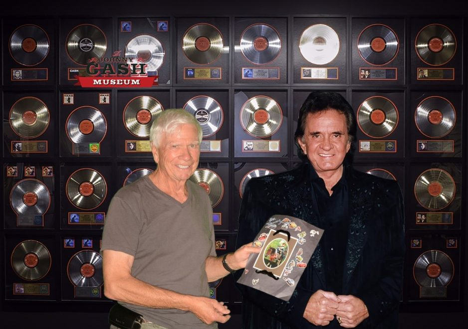 Tom Blake hands a letter to a Johnny Cash figure. Photo: Courtesy of Tom Blake/Johnny Cash Museum