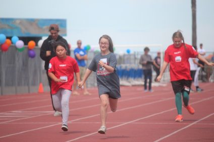 Students run during the 100-meter dash at a Special Olympics event on April 17. Photo: Steve Breazeale