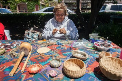 Johnnie Bavier, a member of the Juaneño Band of Mission Indians, Acjachemen Nation, weaves a basket during last year's Fiesta Day celebration.  Photo: Allison Jarrell