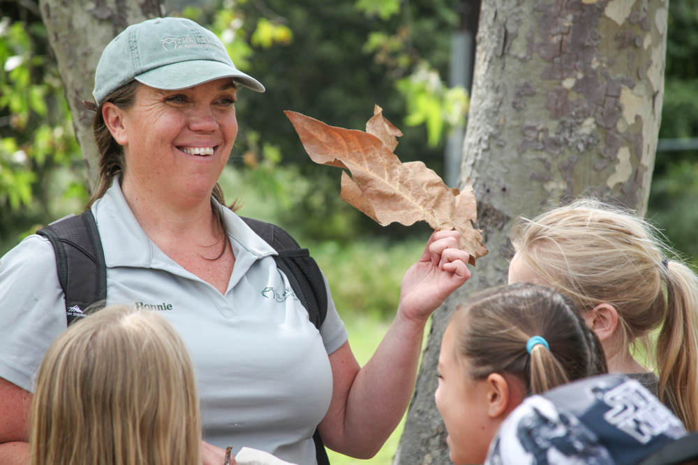 Reserve Education Coordinator Bonnie McQuiston teaches students about different types of leaves.