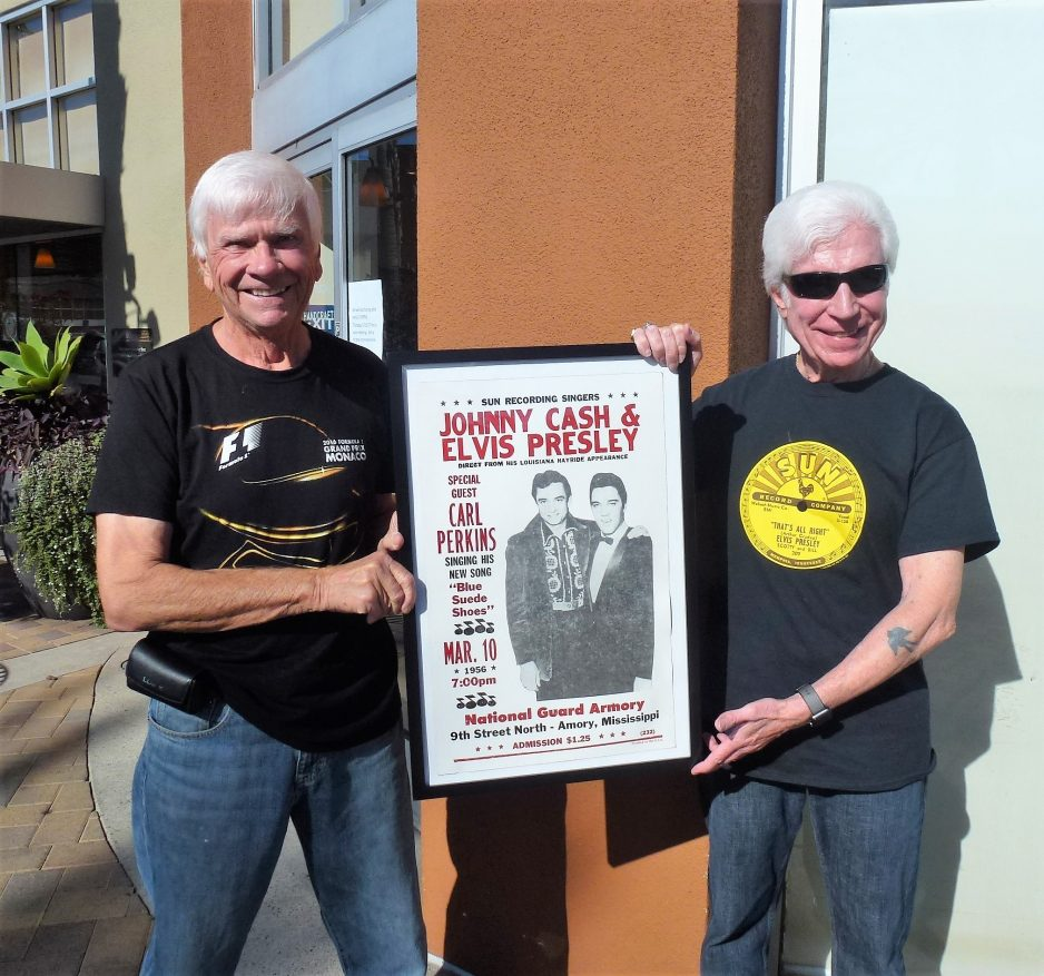 Tom Blake and Michael McLeavy hold a Johnny Cash and Elvis Presley poster promoting a March 10, 1956, concert in Armory, Mississippi. Photo: Courtesy of Tom Blake