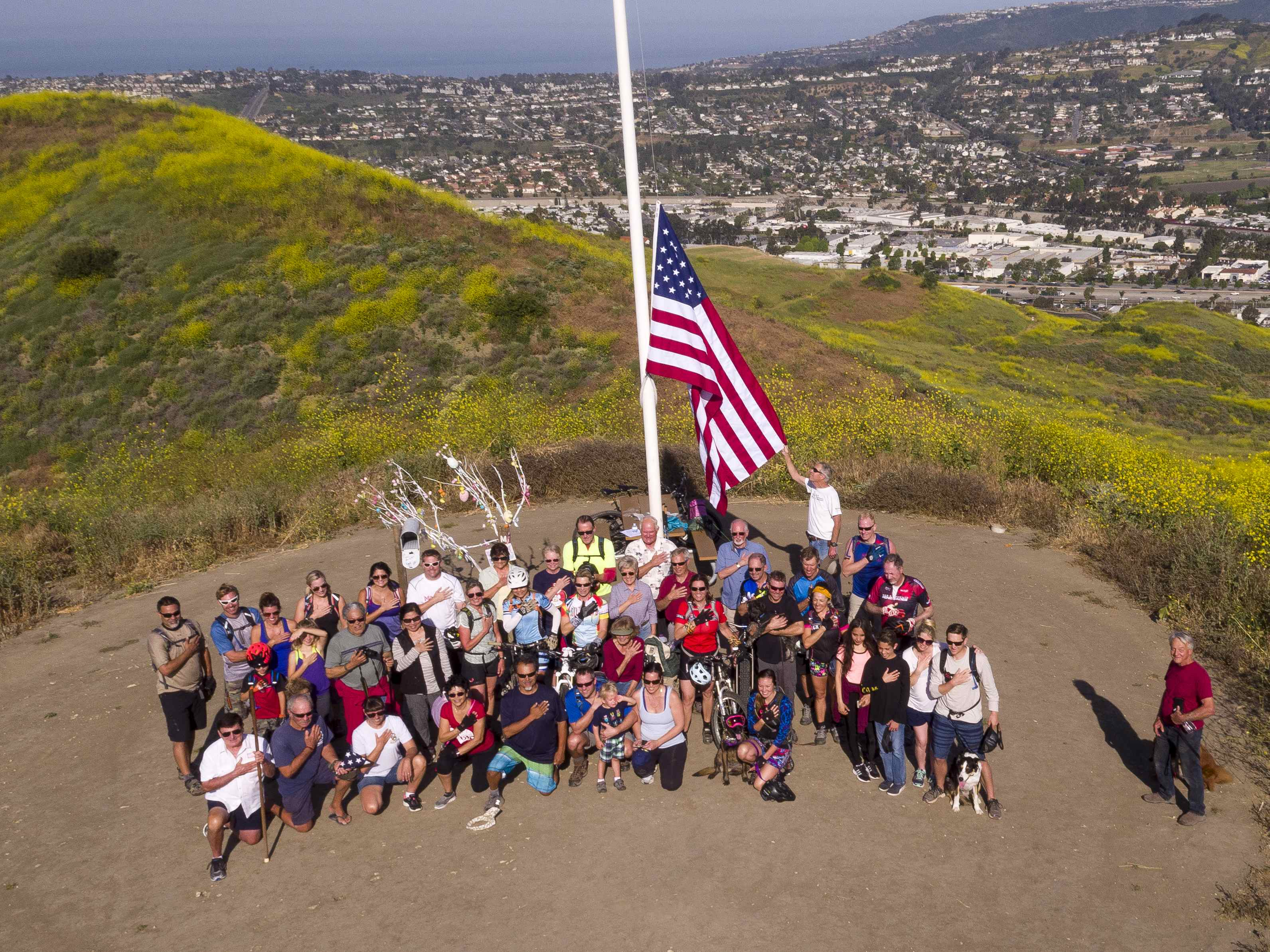 Flag team volunteers replaced the American flag atop Patriot Hill in April. Photo: Courtesy of Tom Baker