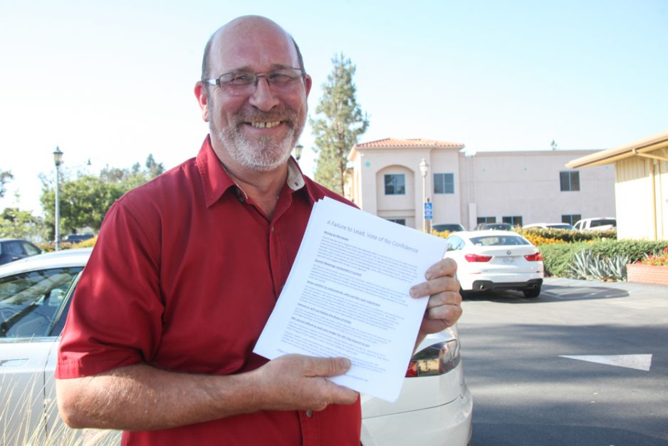 Local business owner Ted Rosenfeldt brought copies of his petition to the June 20 City Council meeting. Photo: Allison Jarrell