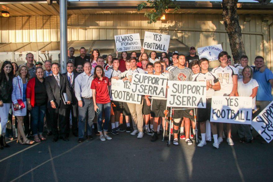 JSerra football players, cheerleaders, staff, parents and supporters pose for a photo after getting City Council approval to have five home football games on campus. Photo: Allison Jarrell