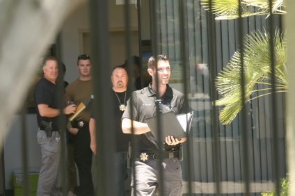 State and federal agents stand at the entrance of Vedanta Laboratories on Tuesday, June 13. The FBI in Los Angeles confirmed the bureau is conducting an investigation into several locations in San Clemente, but the reason for their investigation has been sealed by a federal judge. Photo: Eric Heinz