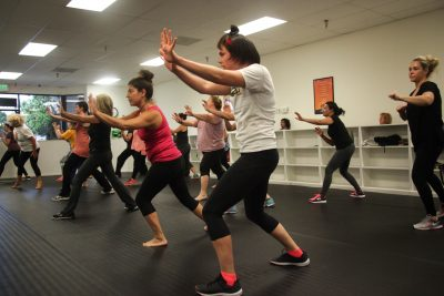 Participants strike a self-defense pose during a free seminar at Zen Dojos Martial Arts Academy.