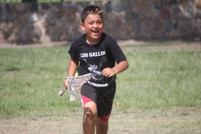 A Los Gallos Lacrosse camper runs through a drill. Photo: Steve Breazeale