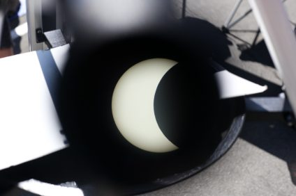 The solar eclipse, as seen through the eyepiece of a white-light telescope. Photo: Allison Jarrell