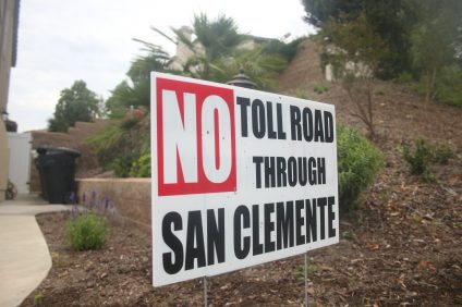 """No Toll Road Through San Clemente"" signs, including one on Costero Risco, are seen throughout the city's residential and commercial properties. Photo: Eric Heinz"