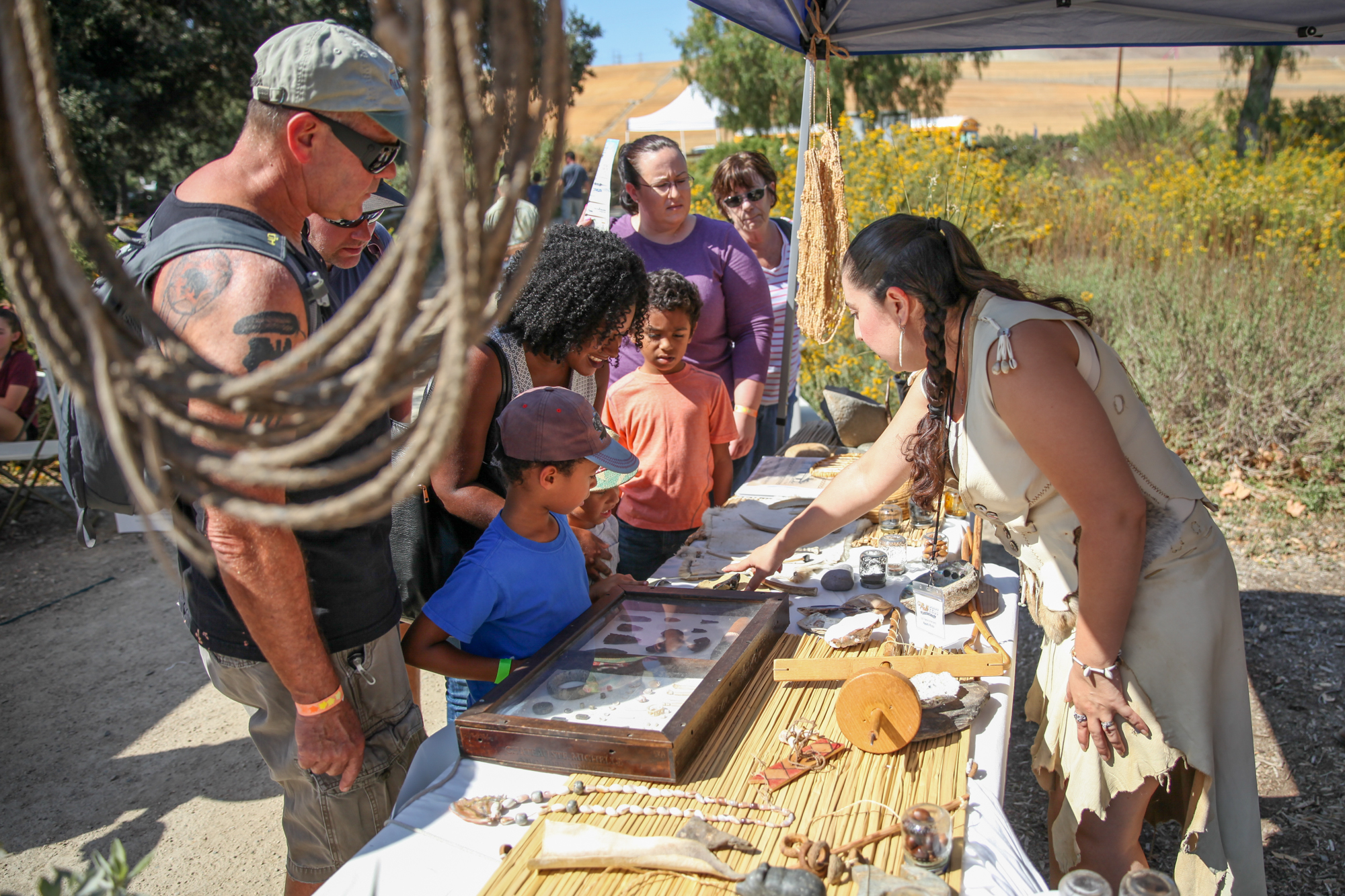 Naomi Knox, of the Juaneño Band of Mission Indians, Acjachemen Nation, tells visitors about the tribe's artifacts on display from the Blas Aguilar Museum. Photo: Allison Jarrell