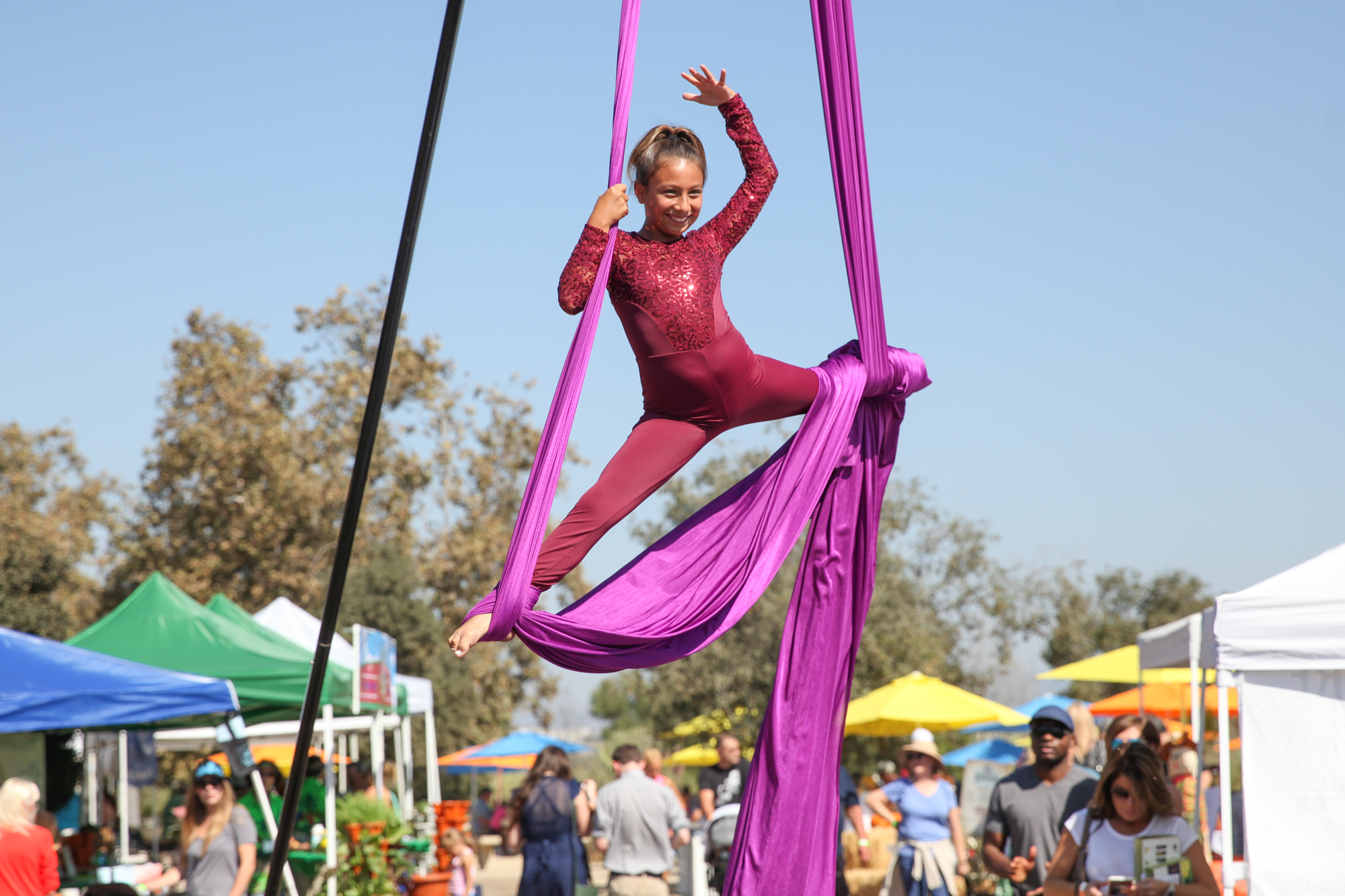 Tatum Cuessy, 11, of Newport Beach, was one of many young performers doing aerial acrobatics from AVANTI Dance Company in Costa Mesa. Photo: Allison Jarrell