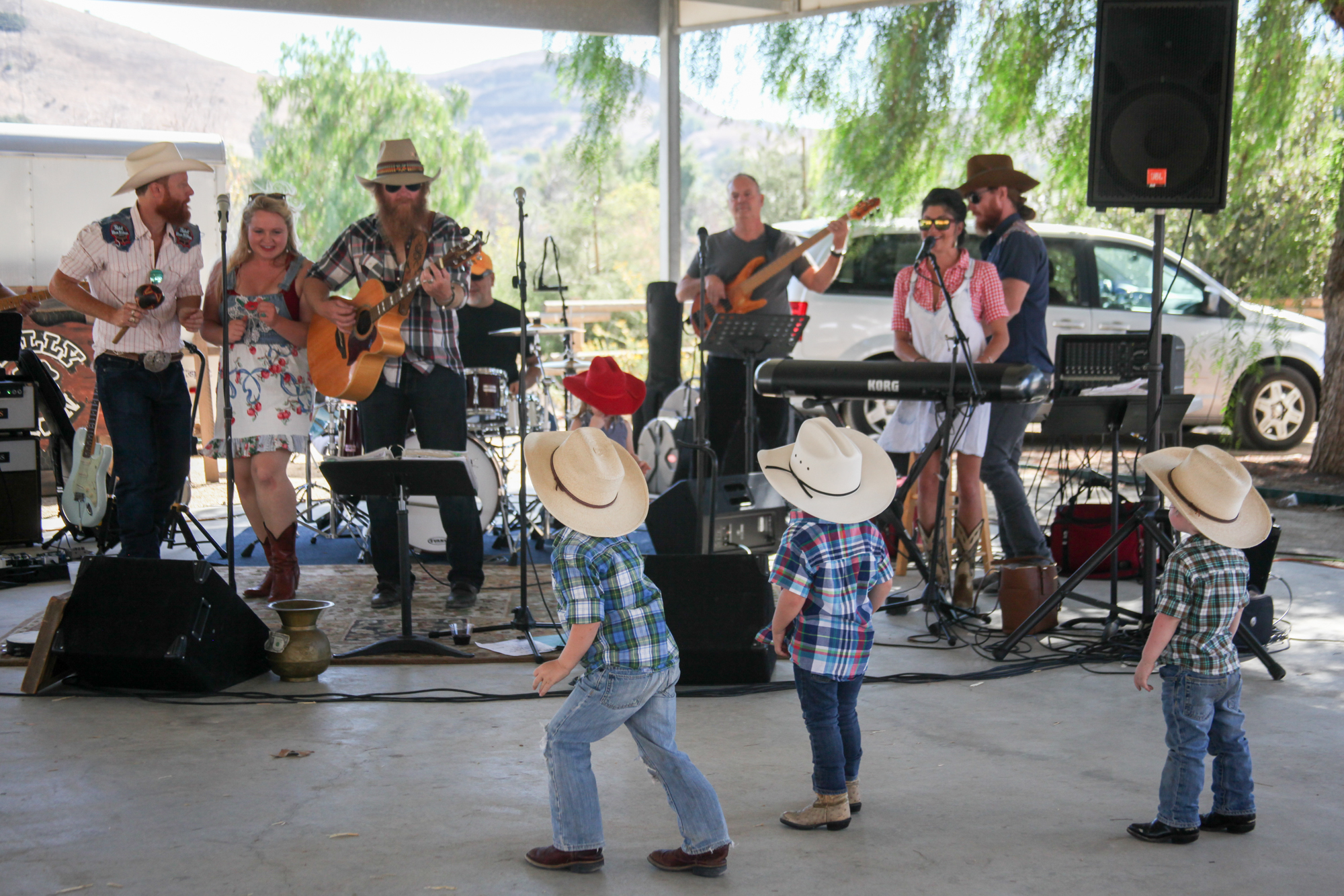 The next generation of Kelly boys watches their parents play at the 2016 Fiesta barbecue. Photo: Allison Jarrell