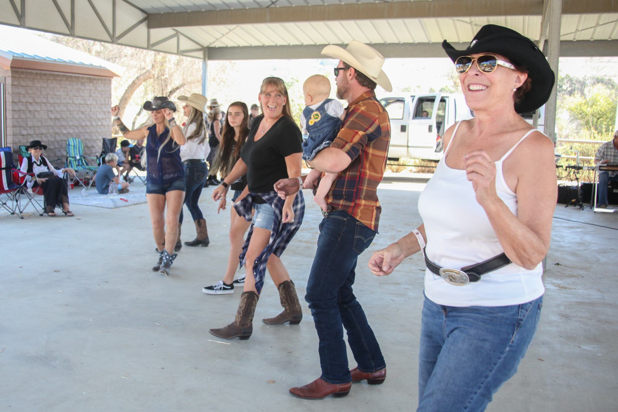 Attendees dance to the music of the Kelly Boyz at the Fiesta Association's 2016 Farewell to the Swallows barbecue. Photo: Allison Jarrell