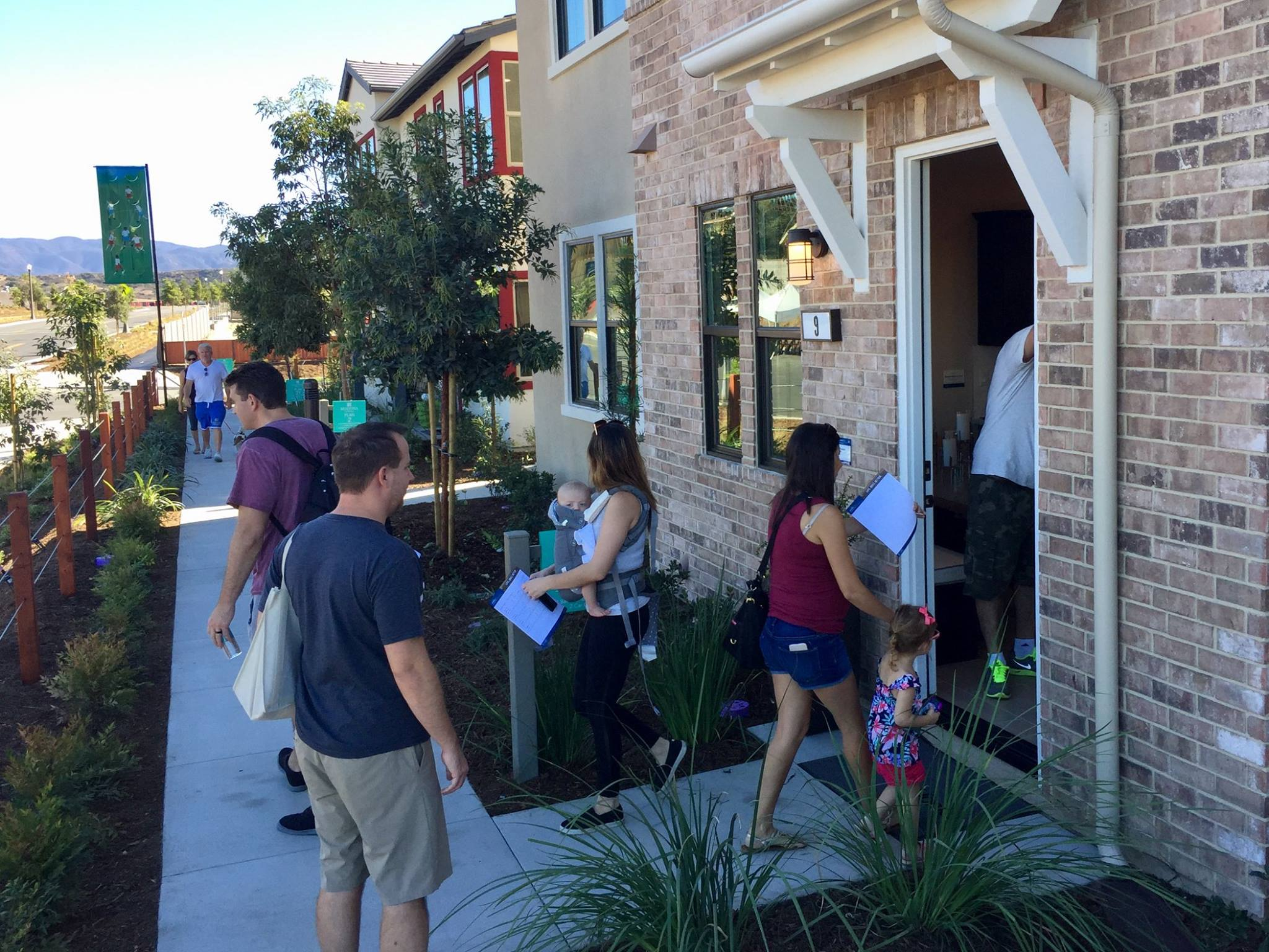 Prospective buyers walk through the new homes in Esencia's NorthWalk Neighborhoods during the Oct. 22 grand opening. Photo: Courtesy of Rancho Mission Viejo