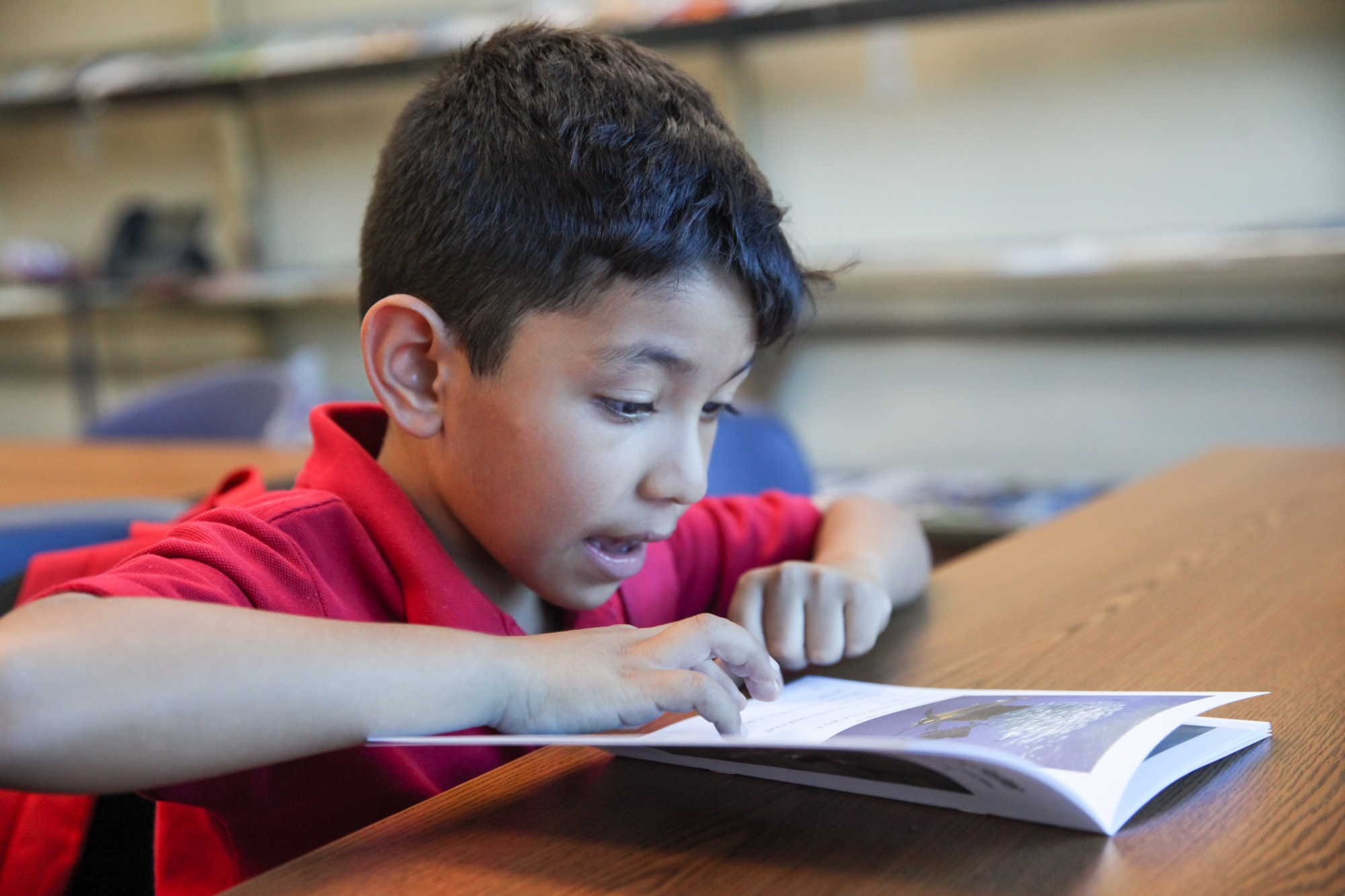 Joshua Pineda participates in a reading exercise during a tutoring session at the Boys & Girls Clubs of Capistrano Valley. Photo: Allison Jarrell