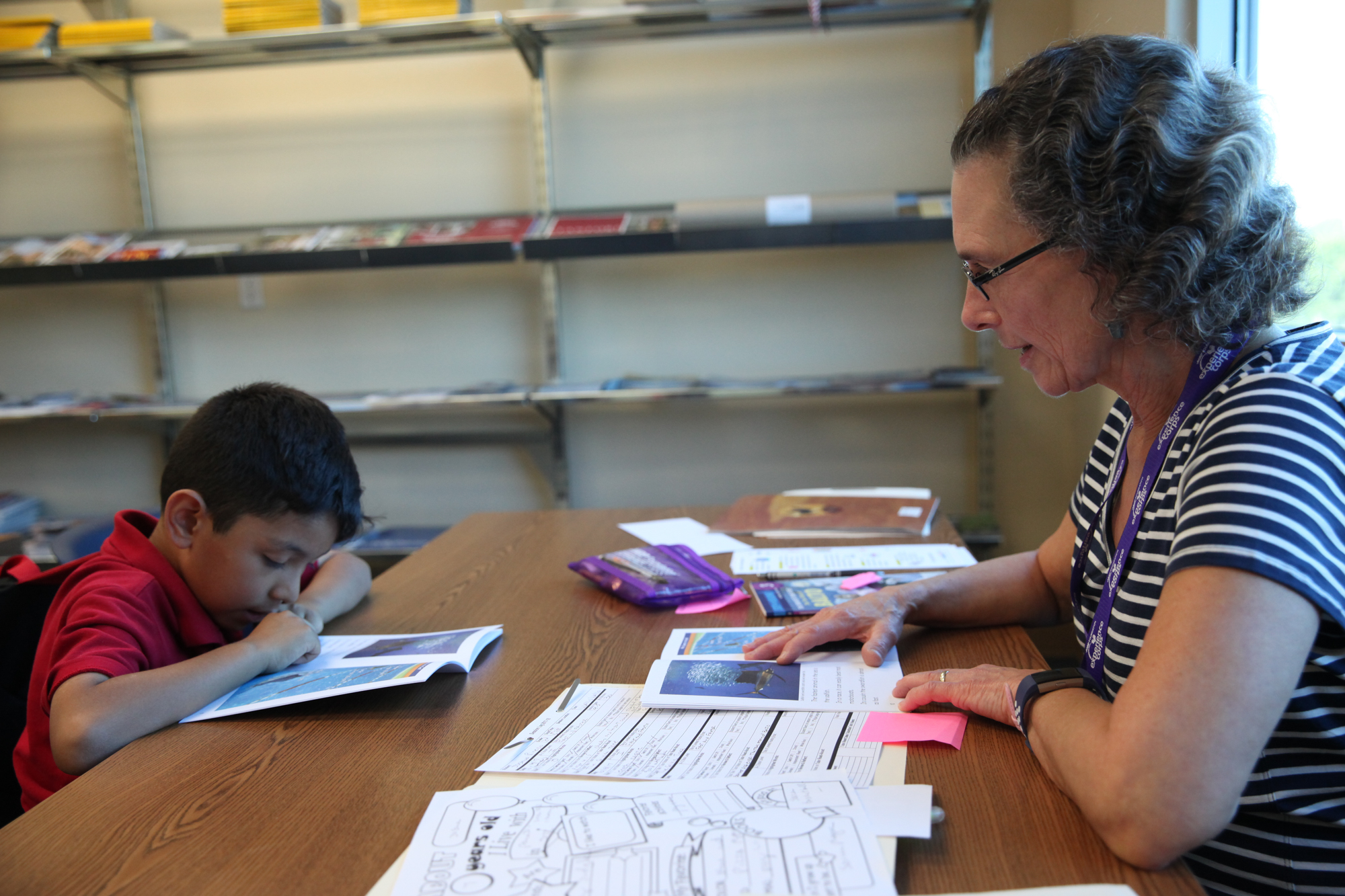 Wallis Wallis, of San Juan Capistrano, leads Joshua Pineda through a reading exercise during a tutoring session at the Boys & Girls Clubs of Capistrano Valley. Photo: Allison Jarrell