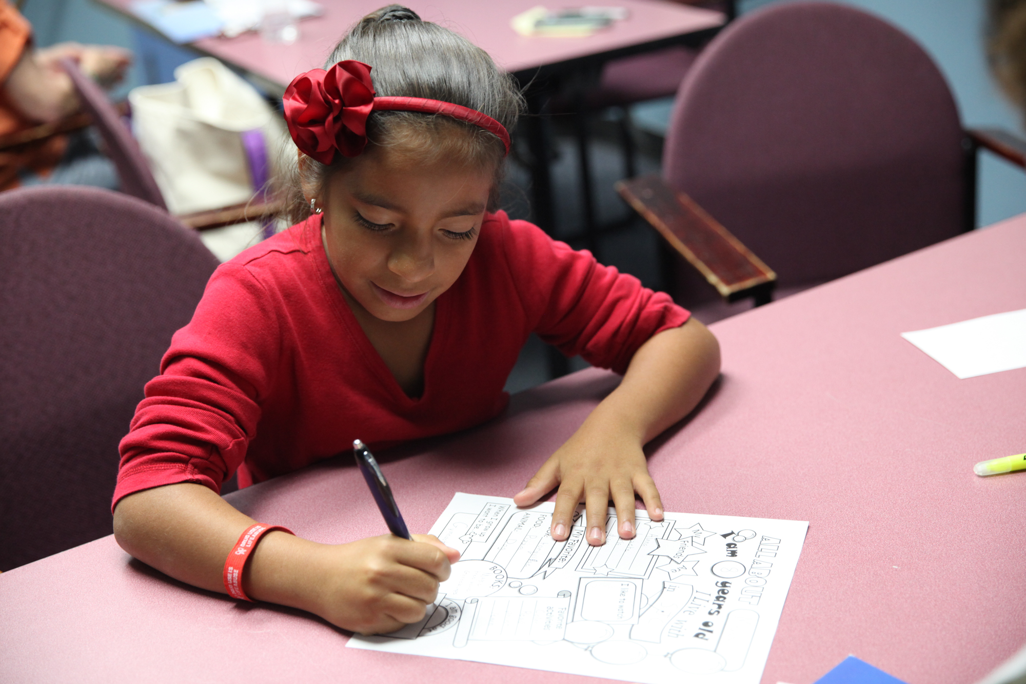 Miranda Rosas fills out an introductory worksheet during her first reading session at the Boys & Girls Clubs of Capistrano Valley. Photo: Allison Jarrell
