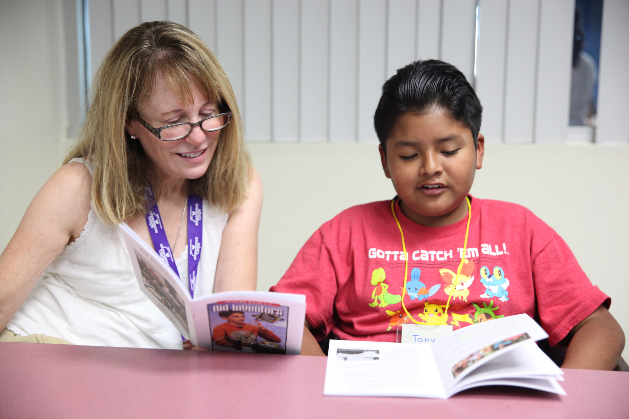 Marilynn Boyle, of San Juan Capistrano, reads with Tony Lopez during the second week of a new tutoring program at the Boys & Girls Clubs of Capistrano Valley. Photo: Allison Jarrell