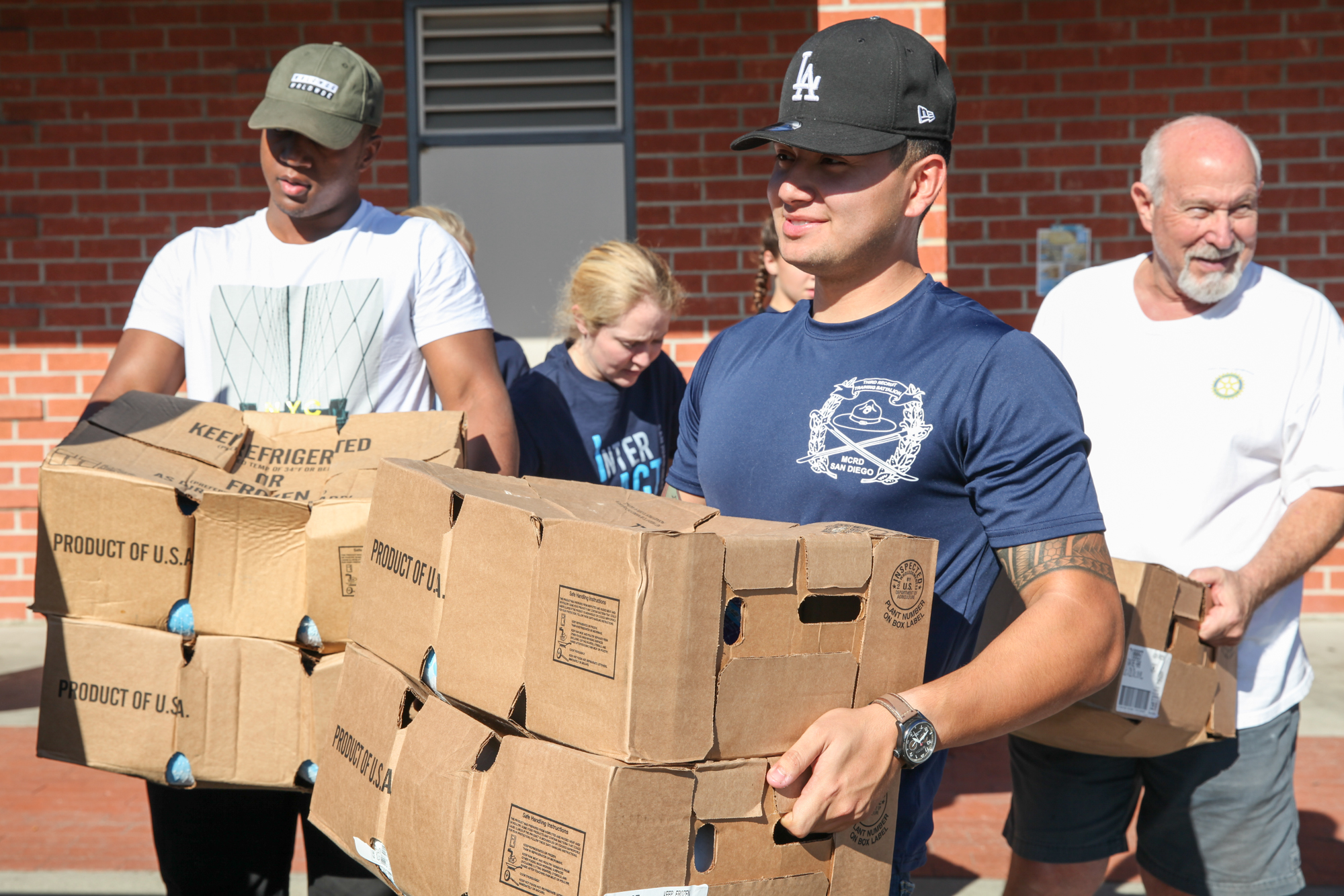 Marcos Vivas, of Camp Pendleton's 1st Battalion, 11th Marines, helps load food donations during the Rotary Club's event on Nov. 18. Photo: Allison Jarrell