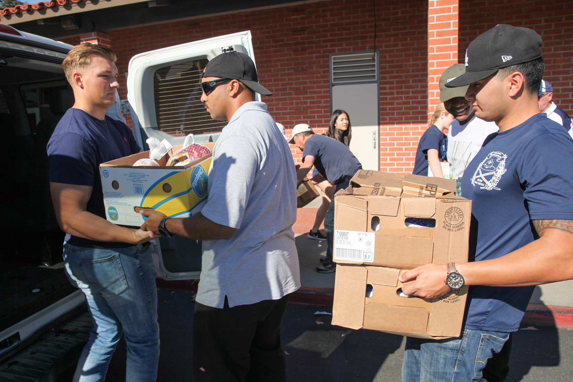 Marines collect meals packed by SJC Rotary Club members and student volunteers for families of the 1st Battalion, 11th Marines. Photo: Allison Jarrell