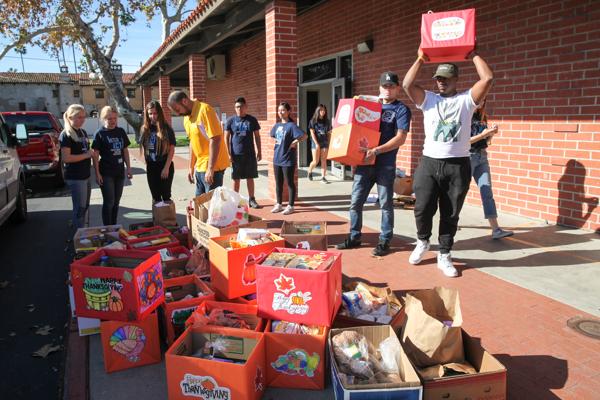 Marines and student volunteers pack up meal donations for families of the 1st Battalion, 11th Marines. Photo: Allison Jarrell