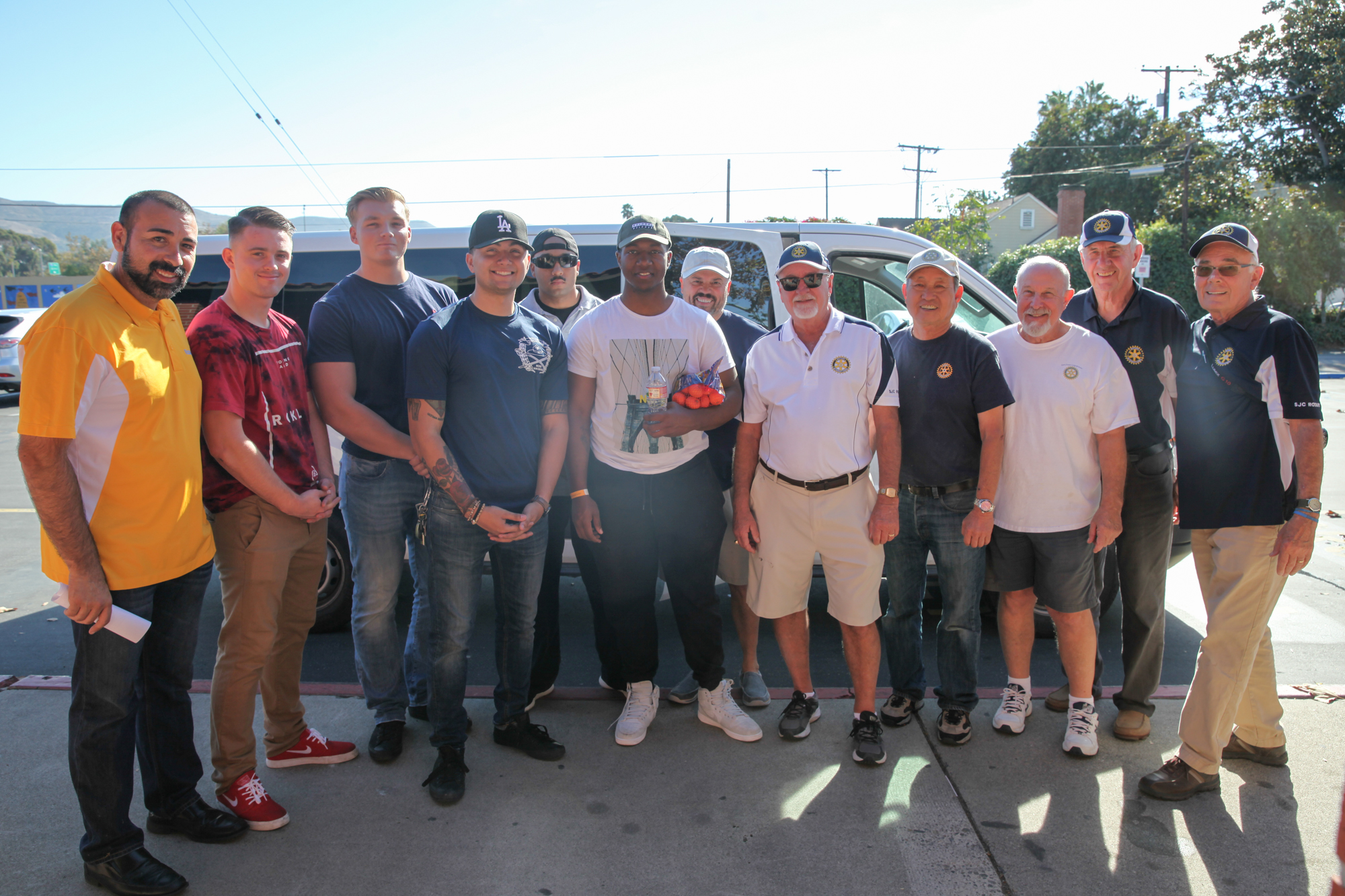 The SJC Rotary Club poses for a quick photo with Marines from Camp Pendleton who came to pick up meal donations for young families on the base. Photo: Allison Jarrell