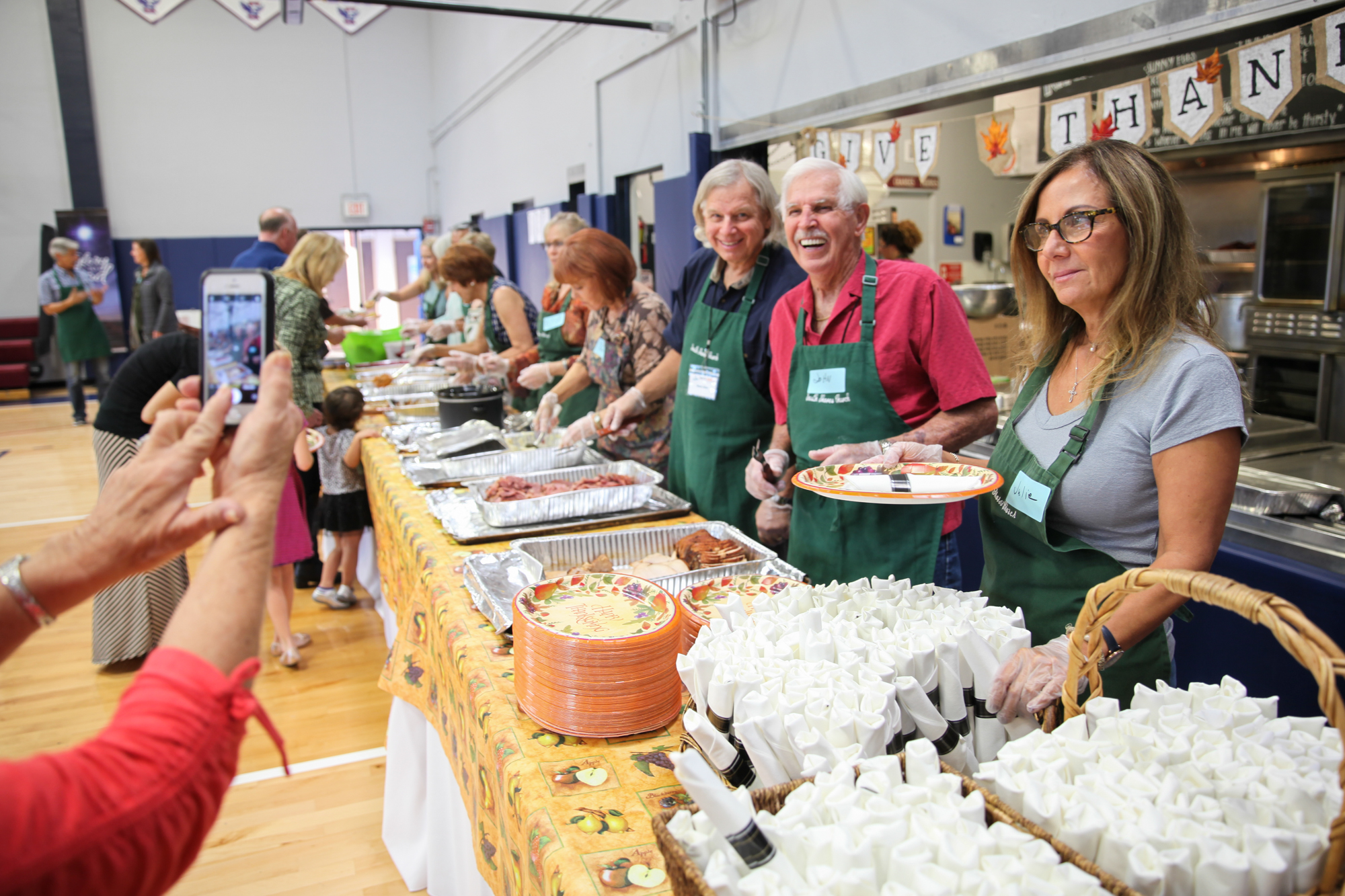 Volunteers get their photo taken during a break in the action at the Love Thy Neighbor Thanksgiving dinner at South Shores Church on Nov. 19. Photo: Allison Jarrell