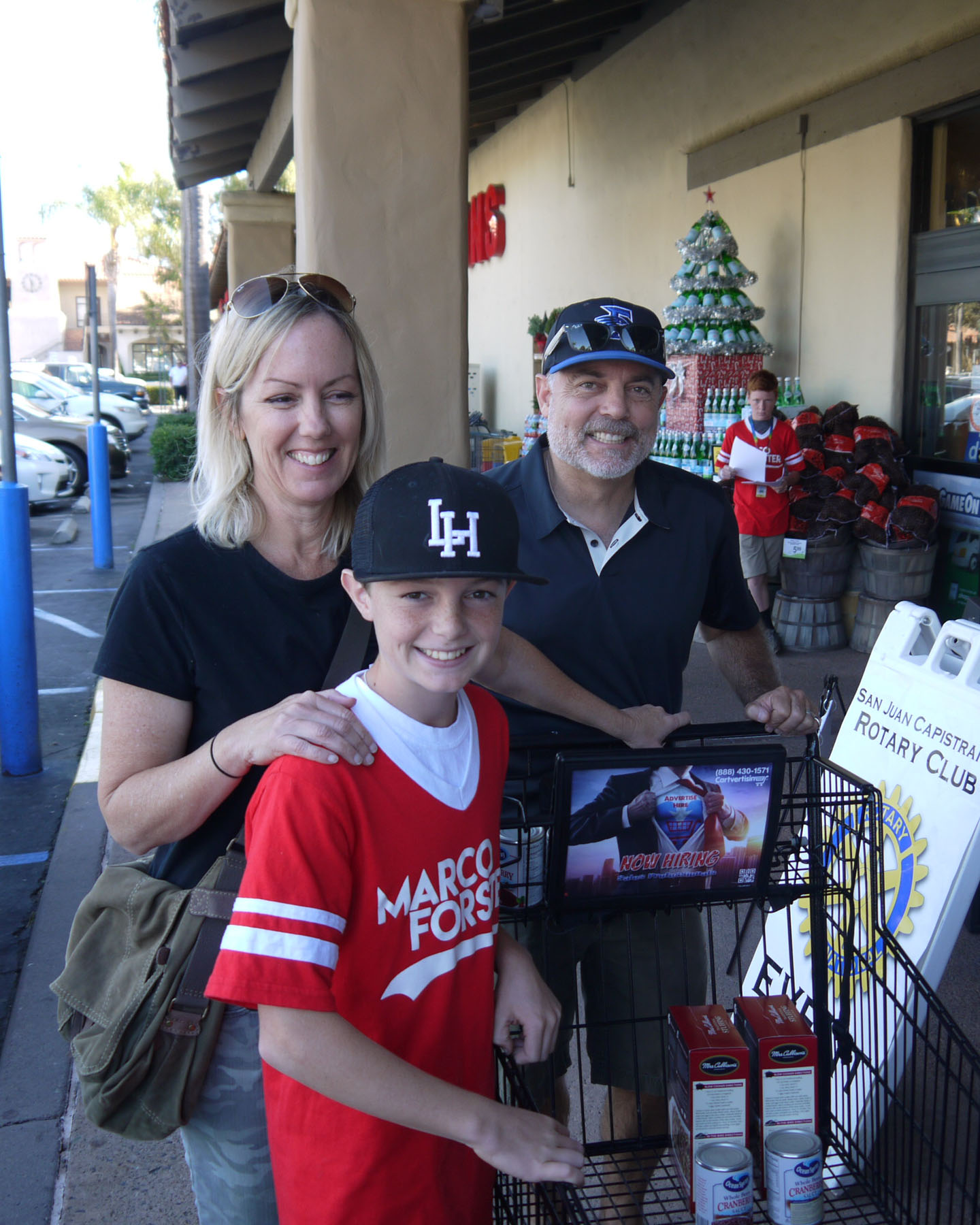 Marco Forster PAL volunteer Marcus Varner and his parents Tracy and Kevin collect food donations for SJC Rotary Club. Photo: John Caldwell
